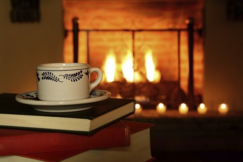 Books and a cup of tea next to the cozy fireplace