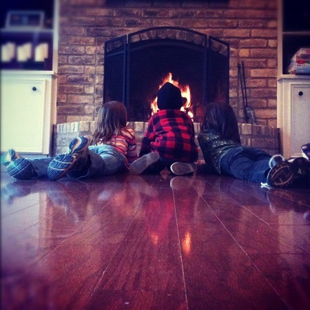 Kids playing by the fireplace